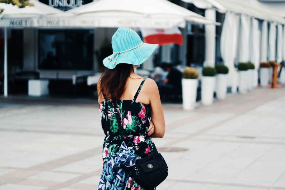 woman wearing multicolored floral camisole dress